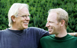 Father and son. Smiling at each other royalty free stock photos