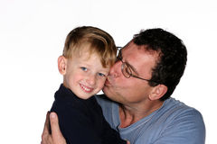 Father and son. Father kissing his toddler son on the cheek stock images