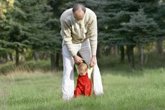 Father and son. Walking in park Royalty Free Stock Photos