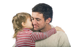 Father and son. Little boy kiss' his father on the white background Royalty Free Stock Photos