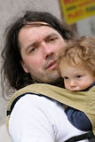 Father and son. Portrait of a father who carries his infant son in baby carrier Royalty Free Stock Image