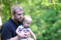 Father and son. Father holding his son in the forest Stock Photos