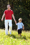 Father and son. Walking in the meadow Stock Images