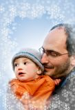 Father and son. On winter background Royalty Free Stock Photo