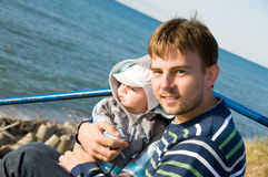 Father with son. Father with his son on sea side royalty free stock photos