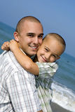 Father and son. Playing at the beach Stock Photography