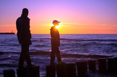 Father with son. Father and son and sunset royalty free stock photos