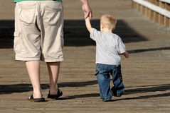 Father and Son. A father and his young son walk hand in hand Royalty Free Stock Photo