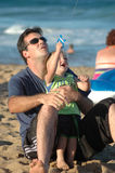 Father and Son. Father teaching his son to fly a kite royalty free stock photography