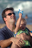 Father and Son. Father teaching his son to fly a kite stock images