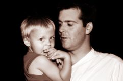 Father and Son. Sepia Image of a father and his son Royalty Free Stock Photo
