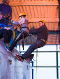 Father and Son Abseiling. Father and son team learning to abseil Royalty Free Stock Photos