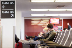 Father and son at the airport. Father and his son waiting and playing at the airport Royalty Free Stock Image