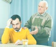 Father and son arguing Stock Photos