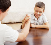 Father and son arm wrestling Stock Photography