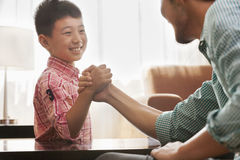Father and Son Arm Wrestling Stock Photos