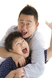 Father and Son. Asian Father and son playing wrestling with isolated white backrgound Stock Images