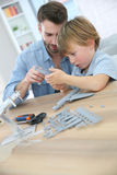 Father and son assembling an aeroplane Stock Photo