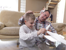 Father and son assembling airplane toy Stock Photography