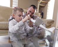 Father and son assembling airplane toy Stock Image