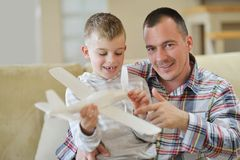 Father and son assembling airplane toy Royalty Free Stock Photos