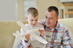 Father and son assembling airplane toy Royalty Free Stock Images
