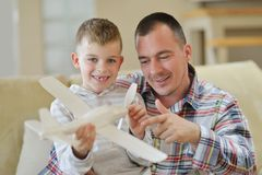 Father and son assembling airplane toy Stock Images