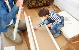 Father and son assembling furniture Royalty Free Stock Photo