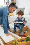 Father and son assembling furniture Stock Photos