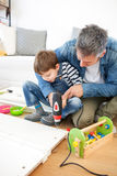Father and son assembling furniture Royalty Free Stock Image