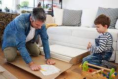 Father and son assembling furniture Stock Image