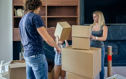 Father and son assembling moving box. Aerial view of unrecognizable father and son assembling moving box royalty free stock photography