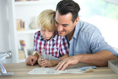 Father and son assembling a toy. Father and kid making a plane model Stock Photography