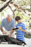 Father Son Auto Repair with Copyspace Stock Photography