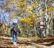 Father and son in autumn forest Stock Photo