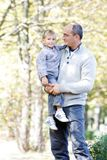 Father and son in autumn park Royalty Free Stock Image
