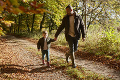 Father And Son On Autumn Walk In Woodland Together Royalty Free Stock Photos