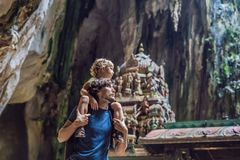 Father and son in the background of Batu Caves, near Kuala Lumpu. R, Malaysia. Traveling with children concept stock photography