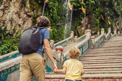 Father and son in the background of Batu Caves, near Kuala Lumpu. R, Malaysia. Traveling with children concept stock images