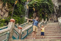 Father and son in the background of Batu Caves, near Kuala Lumpu. R, Malaysia. Traveling with children concept stock photos