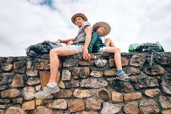 Father and son backpacker traveler rest together sitting on old Royalty Free Stock Images