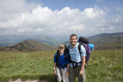 Father and son backpacking in mountains Stock Image