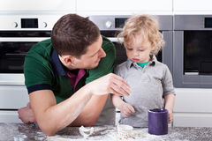 Father and son baking together Stock Photos