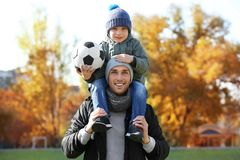 Father and son with ball on  pitch. Father and son with ball on soccer pitch Royalty Free Stock Photography