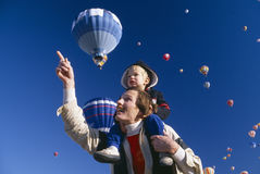 Father and son at balloon festival. Father with young son on his shoulders, Albuquerque's Hot Air Balloon Festival, New Mexico Royalty Free Stock Image