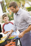 Father And Son Barbequing Royalty Free Stock Photography