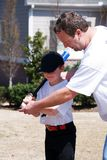 Father and son/baseball lesson stock images