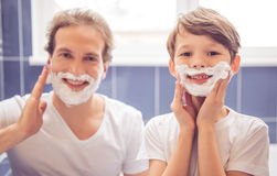 Father and son in bathroom Stock Photo