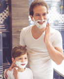 Father and son in bathroom Royalty Free Stock Image