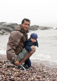 Father and son on a beach Royalty Free Stock Photos